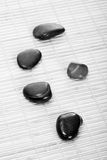 Zen-Stones on bamboomat, bw Stock Photos