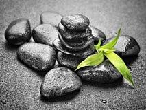 Zen stones. Zen basalt stones and bamboo on the black Royalty Free Stock Images