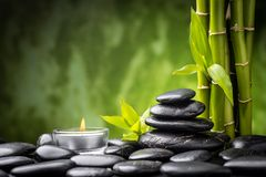 Zen stones. Zen basalt stones and bamboo on the black Stock Images