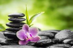 Zen stones. Zen basalt stones ,orchid and bamboo Royalty Free Stock Photos