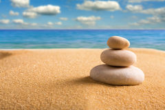 Zen stones on the beach. Macro of three staked zen stones on the beach Royalty Free Stock Photo
