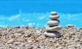 Zen stones on a beach pebble. Sea pebbles tower. Harmony and stability concept.  royalty free stock images