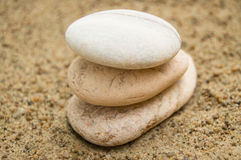 Zen stones on the beach for a perfect meditation, a blurred background Royalty Free Stock Photos