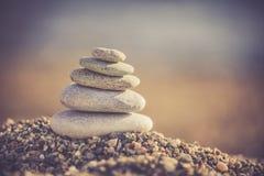 Zen stones on the beach. Pile of zen stones on the beach royalty free stock images