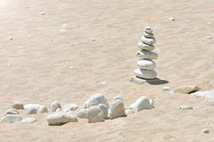 Zen stones on a beach sand. Sea pebbles tower. Harmony and stability concept. Zen stones on a beach sand. Sea pebbles tower. Harmony and stability concept stock images