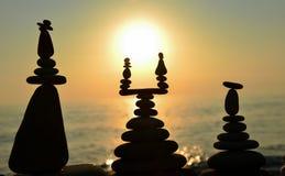 Zen stones on beach at sunset Royalty Free Stock Image