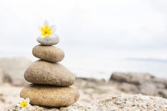 Zen Stones. With Blur Beach Background Royalty Free Stock Photo