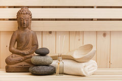 Zen stones and buddha statue in sauna Royalty Free Stock Photography