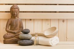 Zen stones and buddha statue in sauna Royalty Free Stock Image