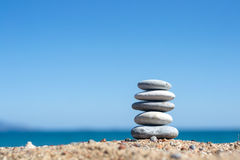 Zen stones. Concept on sunny beach stock photo