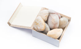 Zen Stones en una caja en un fondo blanco Imagen de archivo libre de regalías