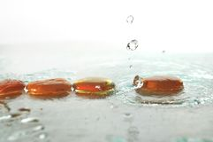 Zen stones with falling water drops Stock Photo