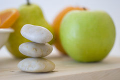 Zen stones and fruits Stock Photo