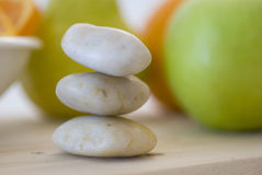 Zen stones and fruits Royalty Free Stock Images