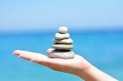 Zen stones hand Stock Images