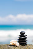 Zen stones jy on the sandy beach near the sea. royalty free stock photo