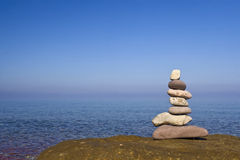 Zen stones near the water. A stack of zen stones near the water Royalty Free Stock Photography