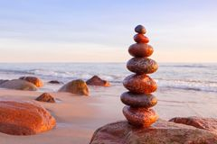 Free Zen Stones On A Background Of Pink Sky And Sea. The Concept Of Peace And Harmony Stock Photography - 163734082