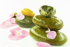 Zen stones and pink flower Royalty Free Stock Photos