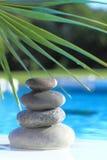 Zen stones pyramid. On water Stock Photos