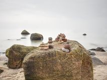 Zen stones pyramids in the beach. Stack of stone on the beach. Balance of soul royalty free stock images