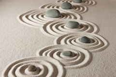 Zen stones. Stones on raked sand. Zen concept Stock Photography