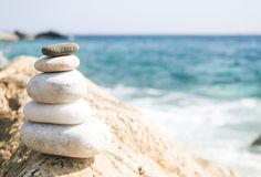 Zen stones. Orizontal image of relaxing Balance  stones with the sea in background Royalty Free Stock Photos
