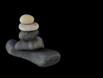 Zen stones rocks spa in stack mindfulness. On  black background with reflection Stock Photography