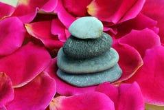 Zen stones on rose petals. Spa concept Stock Photo