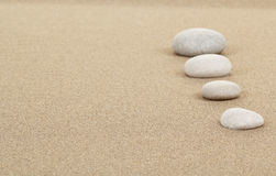 Zen stones in sand Stock Image