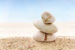 zen stones on sand beach Royalty Free Stock Photo