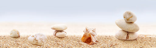 Zen stones on a sandy beach. Stock Photos
