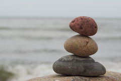 Zen stones at sea. Zen stone pyramid with sea background stock image