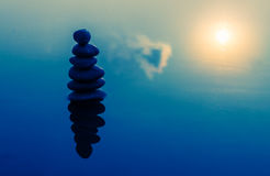 Zen stones stack in sunset Stock Image
