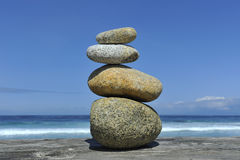 Zen stones stacked at beach copy space. Zen stones stacked at beach against a blue sky and ocean with copy space Royalty Free Stock Image
