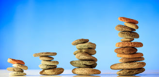 Zen stones stacks on blue sky and sea background Stock Photo
