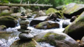 Zen stones stacked in flowing river stock footage