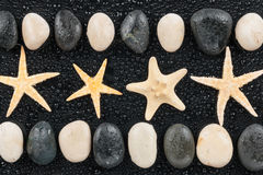 Zen stones and starfish with water drops Stock Photo