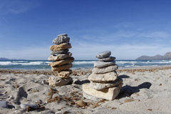 Zen stones tower in a beach. Zen stones tower in a beach beach with blue sky and calm sea. On a summer day in Majorca in the Balearic Islands royalty free stock images