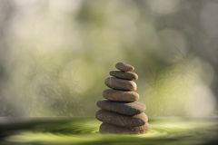 Zen stones in water. Zen stones tower in water with blurred background Stock Image