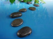 Zen stones in water Royalty Free Stock Images