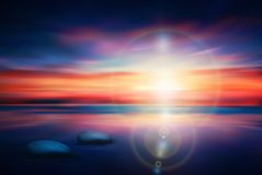Zen stones into water shore at sunset / sunrise, yoga, meditation colorful wallpaper royalty free illustration