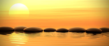 Zen stones in water on sunset. Zen stones into the water with sunset on the background Royalty Free Stock Photos