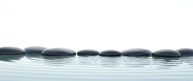 Zen stones in water on widescreen Royalty Free Stock Photos