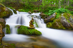 Zen stones& waters of the waterfall Royalty Free Stock Image