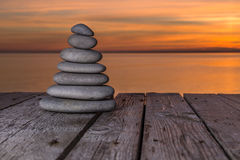 Zen stones on a wooden surface Royalty Free Stock Image