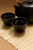 Zen Style. Black oriental teapot & cups, more in my gallery Royalty Free Stock Images