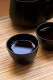 Zen Style. Black oriental teapot & cups, more in my gallery Stock Photos