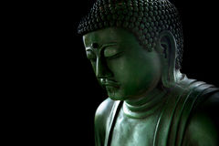 Zen style buddha with light of wisdom black and white. Peaceful asian buddha tao religion art style statue royalty free stock photos
