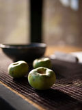 Zen style tea house 1. Persimmons on a desk of Japanese zen style tea house royalty free stock images